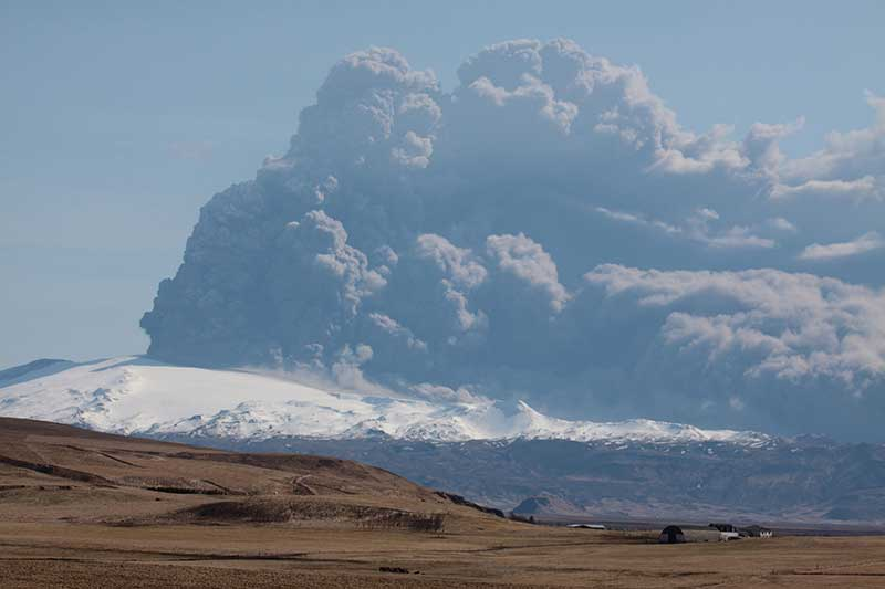 Volcano is belching out a huge cloud of ash.