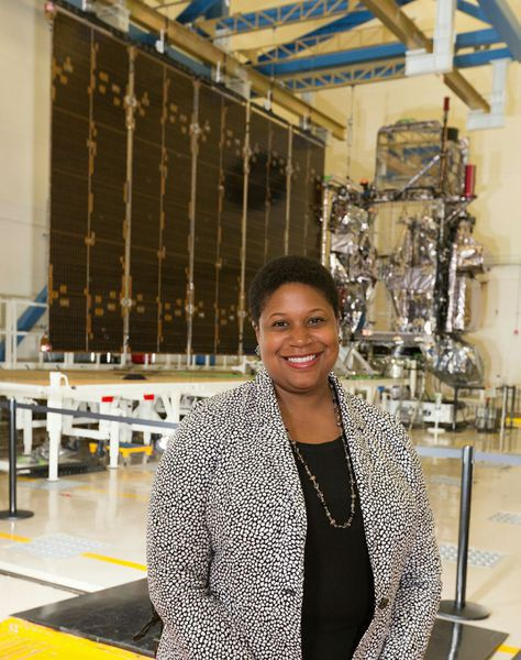 Jamese Sims pictured with the GOES-16 Satellite