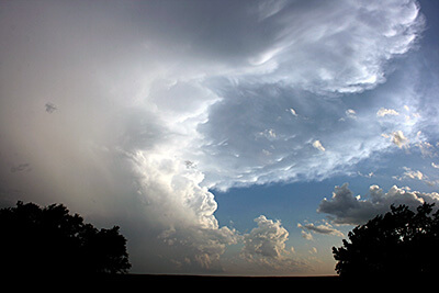 """Cumulonimbus clouds, a combination of """"cumulo"""" and """"nimbo"""" types, normally bringer of storms"""