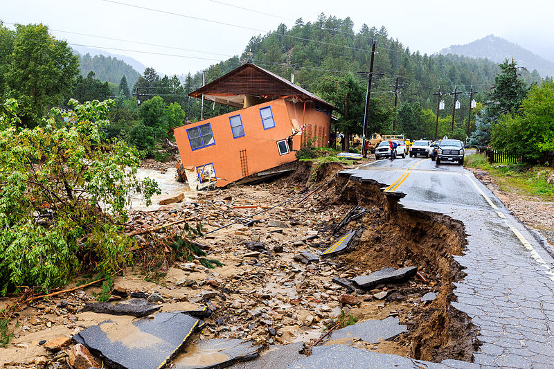 A road destroyed by heavy flooding.
