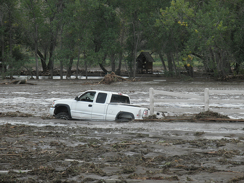 A truck is stuck in floodwater.