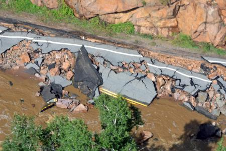 A road destroyed by floodwater