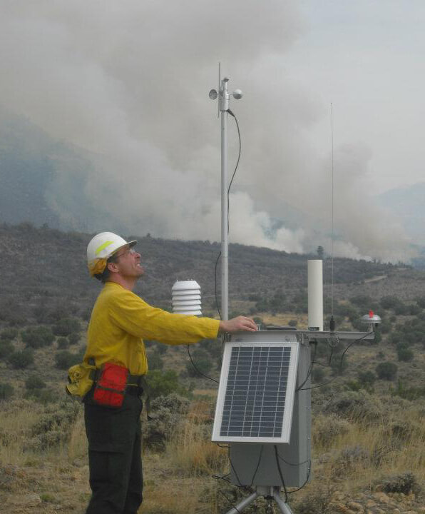 Photo of an incident meterologist in the field.