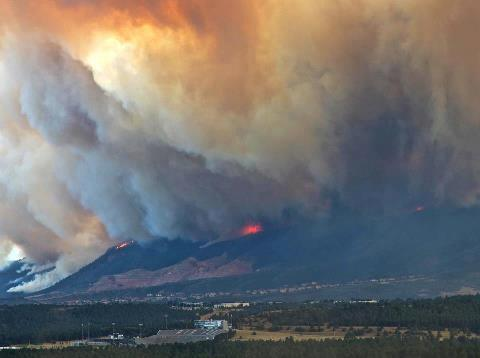 Photo of burning hills surrounding Colorado Springs, CO during the Waldo Canyon Fire.