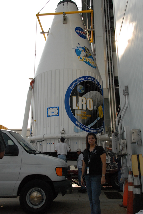 Diana Calero stands with the rocket carrying the Lunar Reconnaisance Orbiter spacecraft.