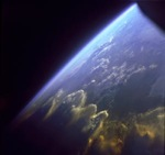 Image of Earth from space, viewing atmosphere at an angle.