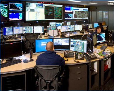 photograph of a USCG rescue coordination center control room.