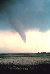 Photo of funnel cloud nearly touching ground.