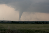 Photo of tornado touching ground.